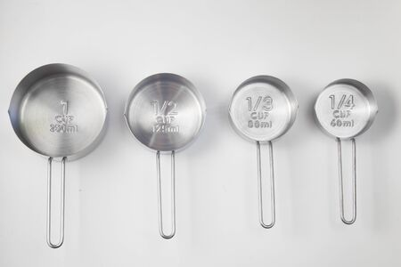 Inox Measuring Cup on white background. Top View