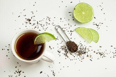 Cup of toasted Erva-Mate Tea with lemon on white background Archivio Fotografico
