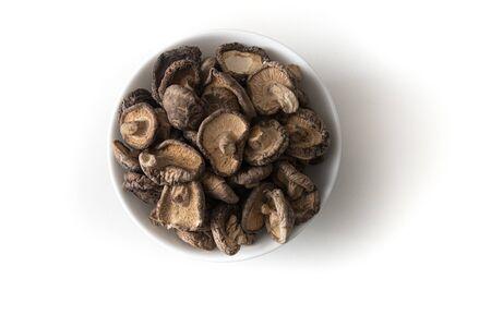 Dried Shitake Mushroom   into a wooden bowl on white background Archivio Fotografico