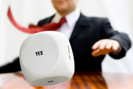 Businessman throwing the dice to make a decision photo