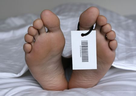 Human feet with toe tag