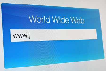 Typing internet address on LCD monitor Stock Photo