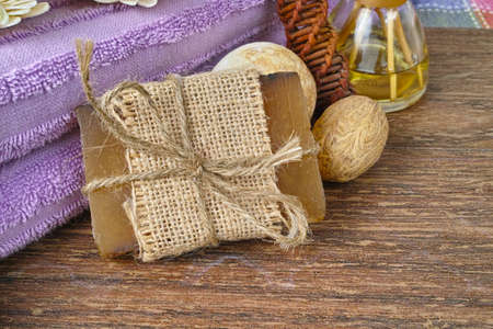 residual: Organic soap, purple sauna towel and walnut tree decoration on background, layout with free text space Stock Photo