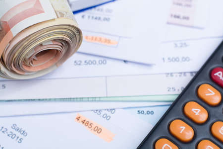 euro banknotes: Invoices and bills, roll of Euro banknotes, calculator, different amounts Stock Photo