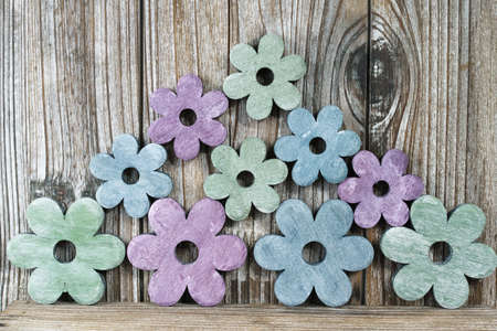sweet home: Colorful wooden flowers on wooden background, sweet home concept, copy space Stock Photo