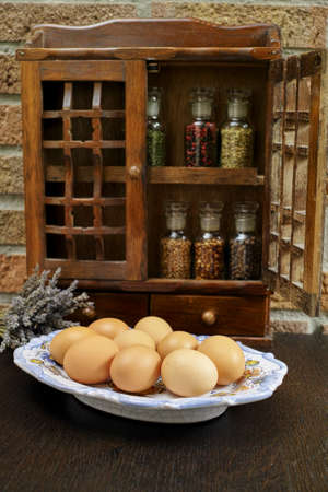 rack mount: Farms vintage Spice Rack or Storage Cabinet: Wall Mount - Display Shelf, Two Drawers, Six Glass Bottles on rural background with fresh organic eggs, village life