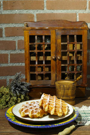 sugar powder: Handmade fresh belgian waffles with sugar powder on rural wooden background