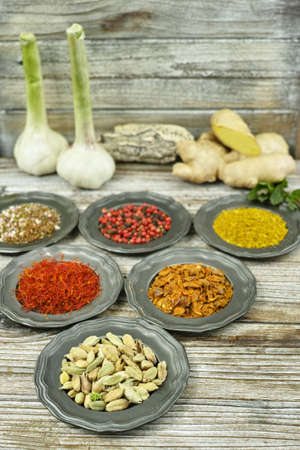 food additives: Spices and herbs in metal bowls. Food and cuisine ingredients. Colorful natural additives. Stock Photo