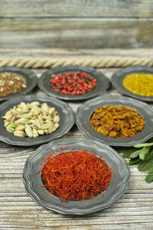 additives: Spices and herbs in metal bowls. Food and cuisine ingredients. Colorful natural additives. Stock Photo