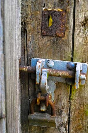 doorlock: Old wood textured door and rusty iron doorlock close up Stock Photo