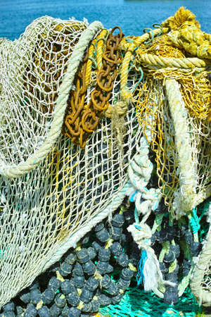 iron chain: Fishermans nets and old iron chain, background Stock Photo