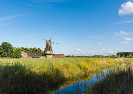 Dutch summer landscape with windmill