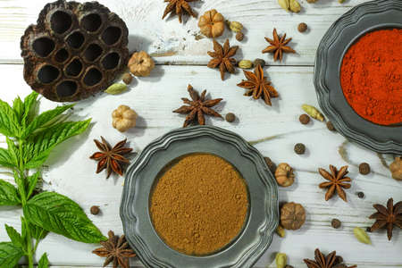 variability: Colorful variety of Indian spices on white wooden table top