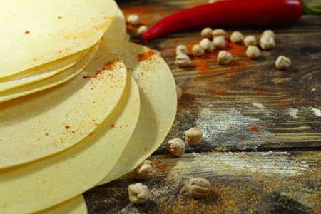 red gram: Colorful Indian food - papadum, chickpea,  gram flour and spices on textured wooden table top
