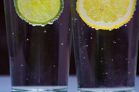 seltzer: Glass with cold sparkling mineral water, lime and lemon, seltzer Stock Photo