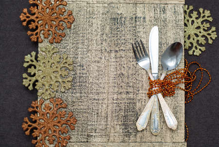 grunge cutlery: Vintage silverware on wooden background with Christmas decoration.
