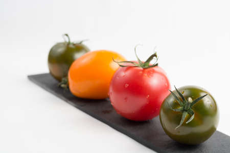 white washed: Ripe colorful red and green kumato tomatoes  isolated
