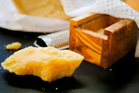 cheese grater: Parmesan cheese. Grated Parmesan cheese and Olive Wood Parmesan Cheese Grater.