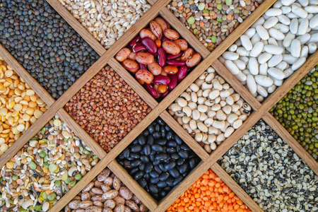 Collection assorted of lentils, beans, peas, grain, groats, soybeans, legumes in wooden box