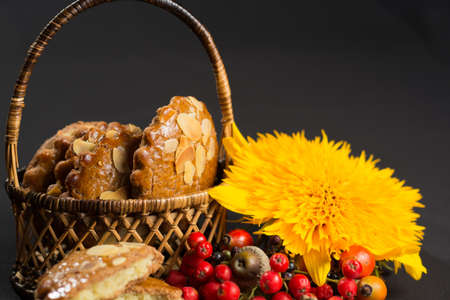Typical Dutch filled spicy  cookies with almonds on autumn colored and dark background