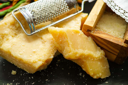 grated parmesan cheese: Parmesan cheese. Grated Parmesan cheese and Olive Wood Parmesan Cheese Grater.