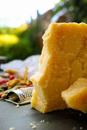 cheese grater: Parmesan cheese. Parmesan Cheese Grater. Multicolored homemade fusilli pasta from Salerno, Italy.