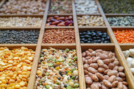 mung: Collection assorted of lentils, beans, peas, grain, groats, soybeans, legumes in wooden box