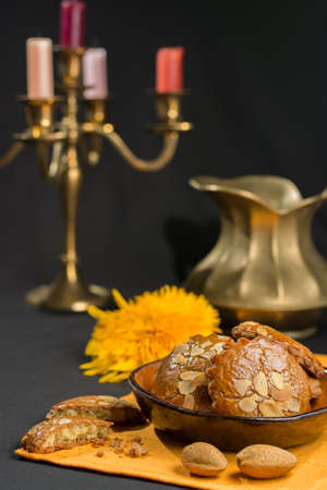 dutch typical: Typical Dutch filled spicy  cookies with almonds on autumn colored and dark background