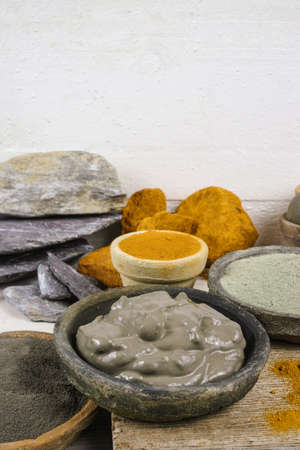 ochre: Ancient minerals - ochre, green and blue clay powder and mud mask for spa, beauty concept