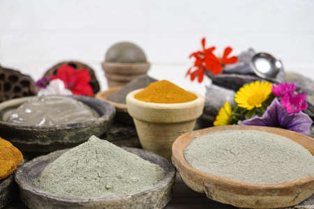 ochre: Ancient minerals - black, green, blue, ochre clay powder and mud mask for spa, beauty concept
