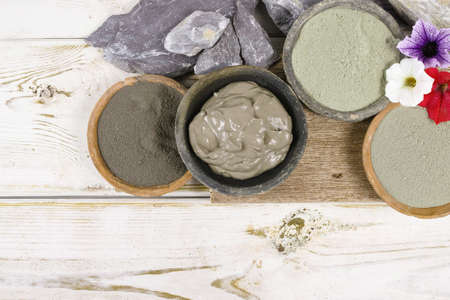Ancient minerals - green and blue clay powder and mud mask for spa, beauty concept Banco de Imagens