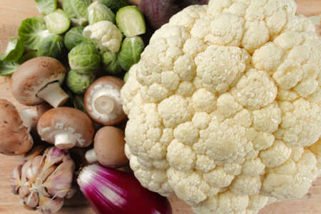 Cauliflower, mushrooms and brussels sprouts - fresh healthy vegetables for cooking
