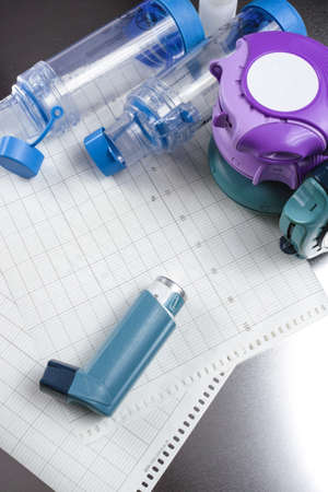 aerosol: Asthma relief concept, salbutamol inhalers, aerosol medication and paper on chrome background