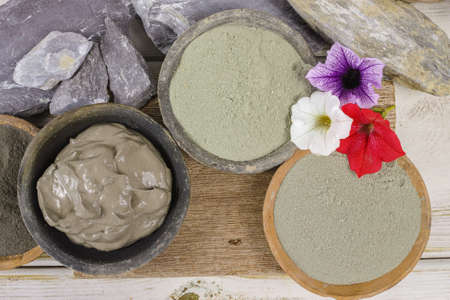 Ancient minerals - green and blue clay powder and mud mask for spa, beauty concept Standard-Bild