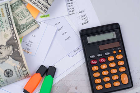 privat: Utility or mortgage bills, calculator and US dollars - finance concept, payments and problems Stock Photo