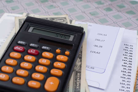 Utility or mortgage bills, calculator and US dollars - finance concept, payments and problems Standard-Bild