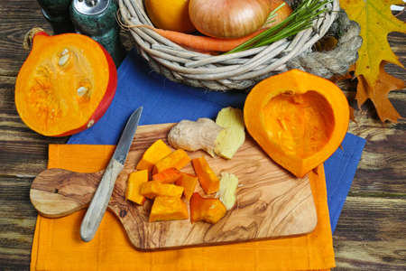 carrot tree: Fresh ingredients for pumpkin soep with apple, orange, carrot and onion on wooden background Stock Photo