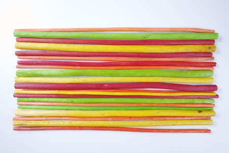 red straw: Decorative colorful wooden sticks on white background Stock Photo