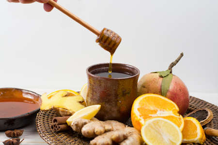 thea: Natural flu and cold remedy - orange and lemon fruit, fresh ginger, honey - alternative medicine, health concept