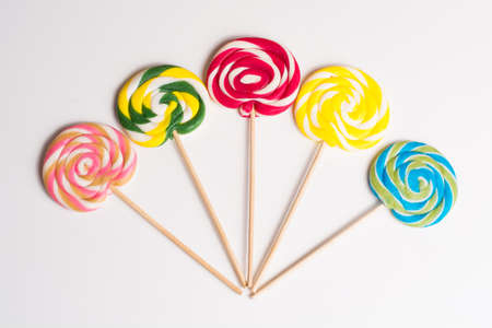 sweetstuff: Multicolored sweet candy canes on wooden sticks, variety Stock Photo