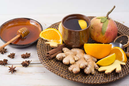 Natural flu and cold remedy - orange and lemon fruit, fresh ginger, honey - alternative medicine, health concept