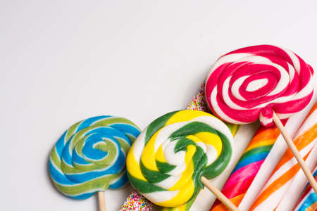 fruit candy: Multicolored sweet candy canes and twirls on wooden sticks, variety