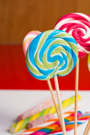 sweetstuff: Multicolored sweet candy canes and twirls on wooden sticks, variety
