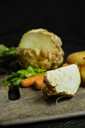 Ingredients for celeriac soup - celery root - celeriac, carrots, onion, potatoes - healthy diet concept