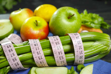 Green vegetables and fruits -  celery shoots and  apples, healthy fitness diet concept