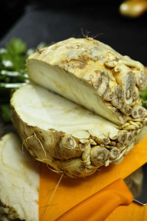 vitamine: Celery root - celeriac, source of vitamine, fresh healthy vegetable, wedge