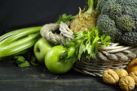 Green vegetables and fruits -  celery, apples, celery root celeriac, broccoli, healthy diet concept