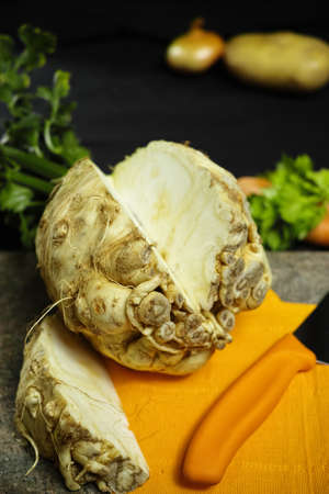 vitamine: Celery root - celeriac, source of vitamine, fresh healthy vegetable, wedge