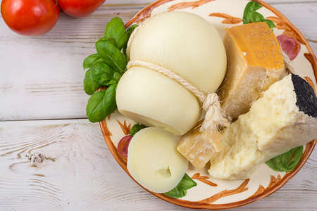 Best Italian food - fresh caciocavallo, pecorino, parmesane cheese on ceramic plate