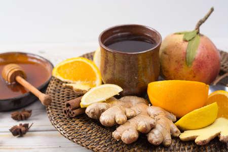 Natural flu and cold remedy - orange and lemon fruit, fresh ginger, honey - alternative medicine, health concept